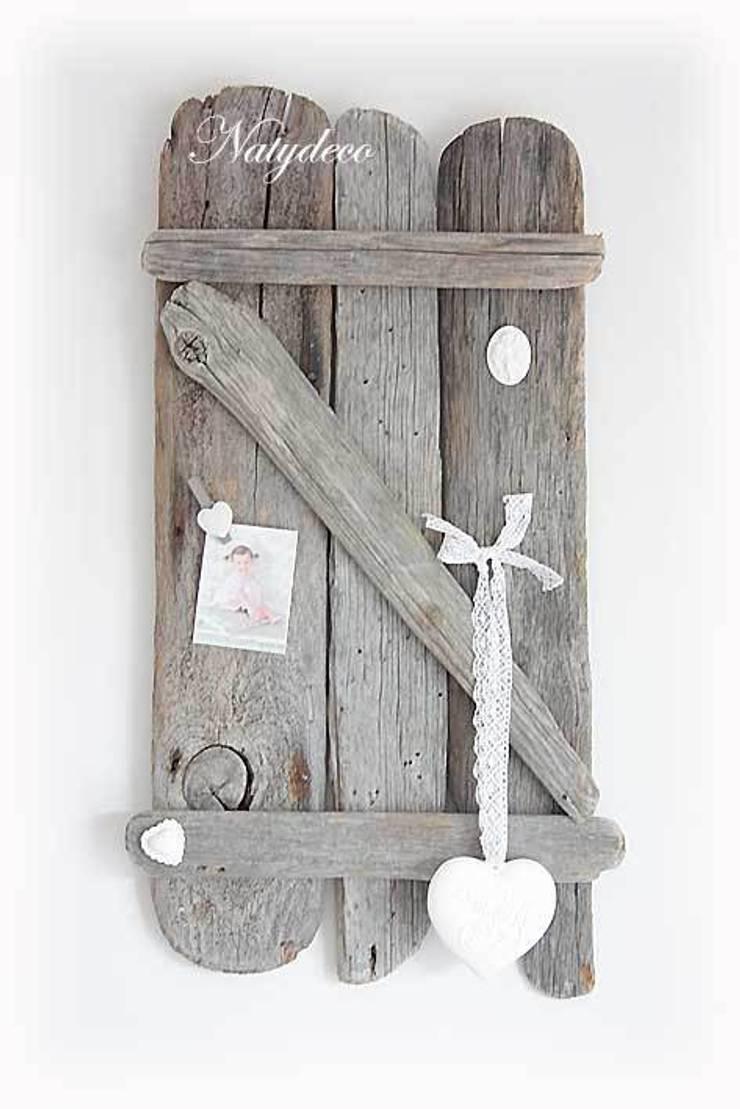 décoration en bois flotté: Maison de style  par Natydeco