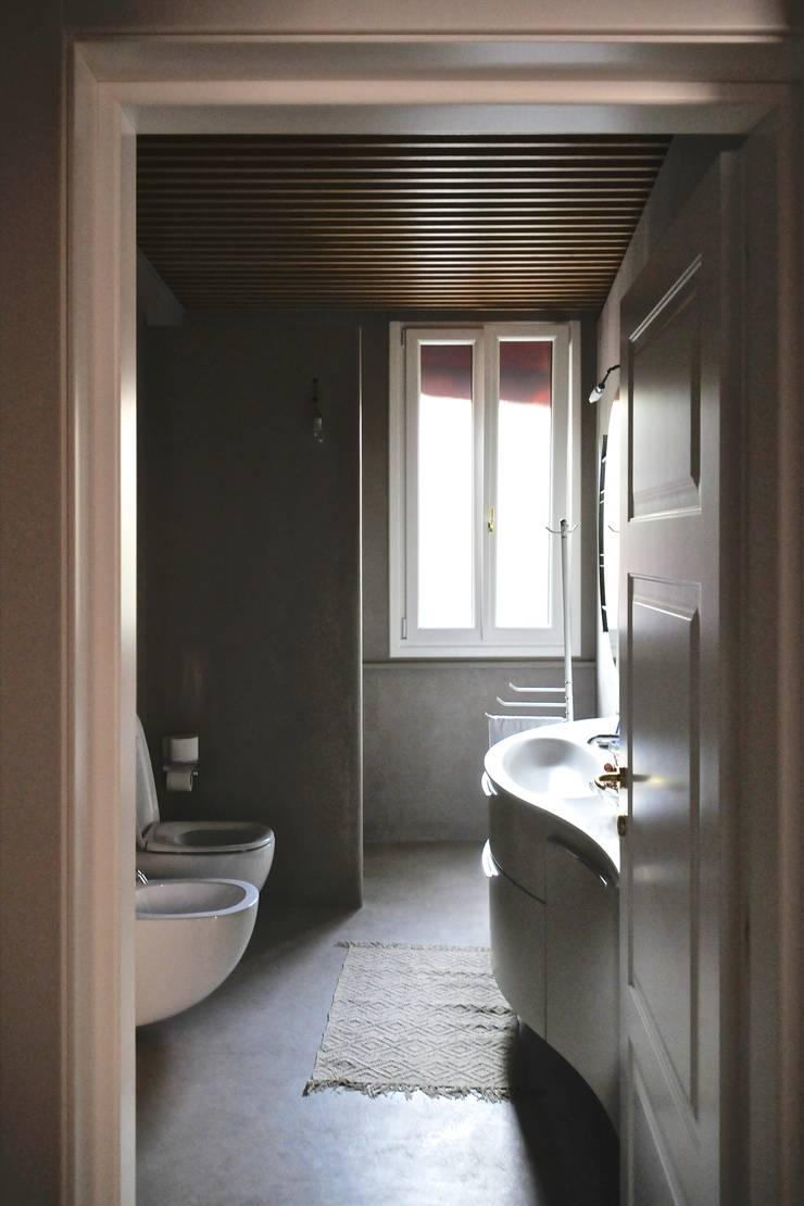 Casa RN.ML: Case in stile  di Angeli - Brucoli Architetti,