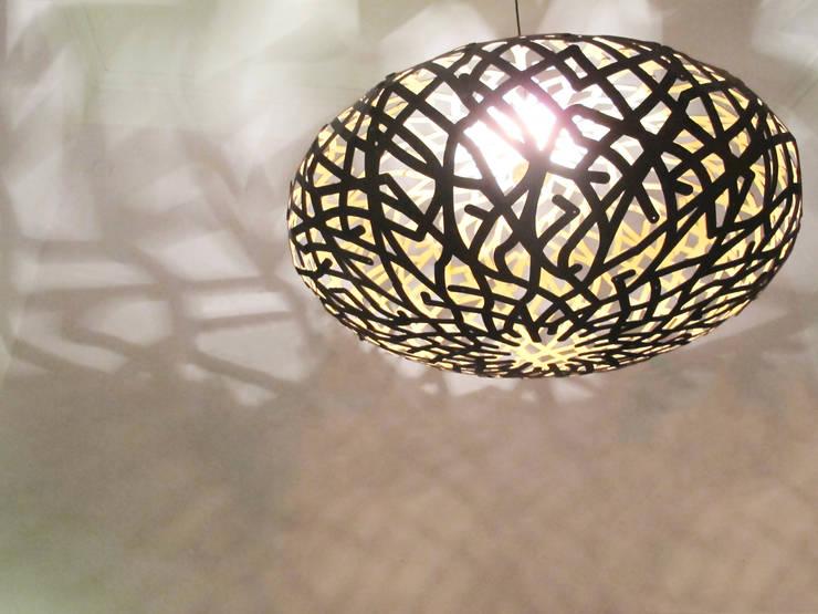 Canopée: Paysagisme d'intérieur de style  par Louis-Marie Schulthess