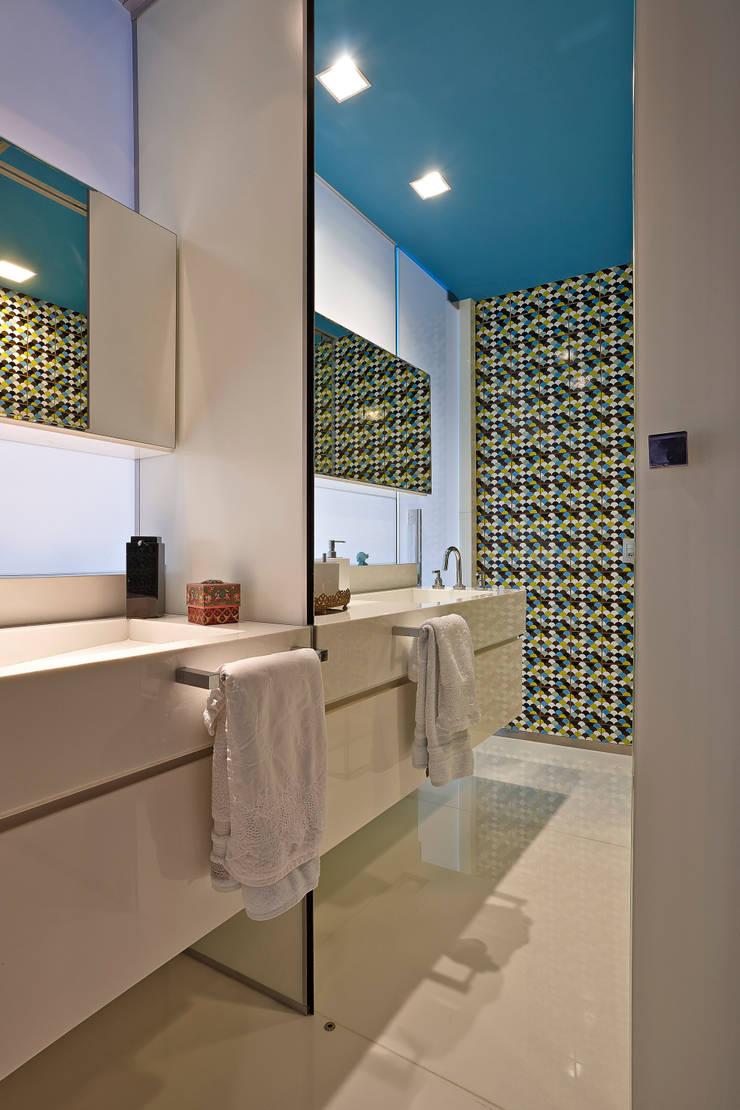 Apartamento Santo Agostinho: Casa  por Gislene Lopes Arquitetura e Design de Interiores