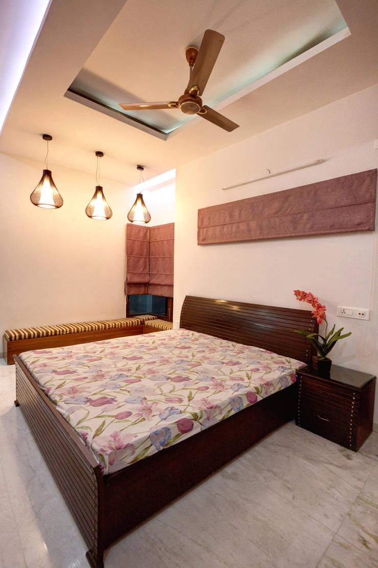 Bedroom: modern Houses by Studio An-V-Thot Architects Pvt. Ltd.