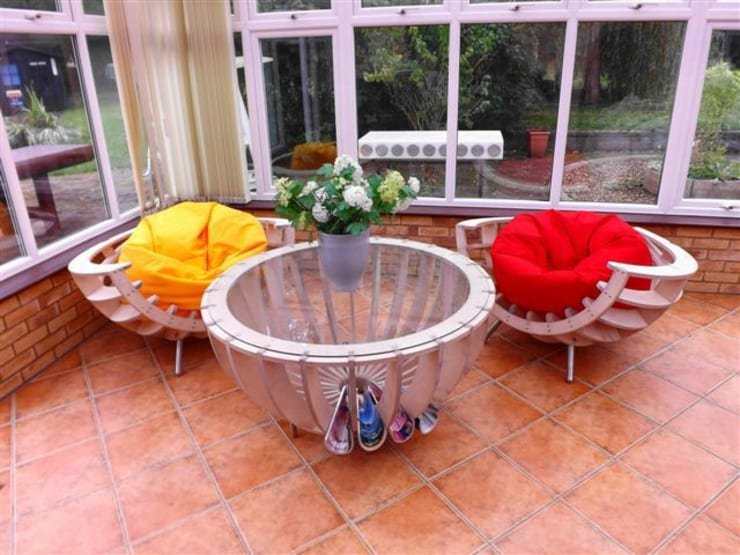 spherical influenced conservatory furniture:  Living room by srb enginering 2000 ltd