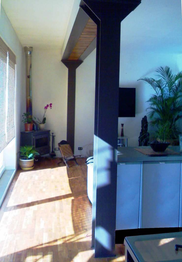 Il soggiorno: Case in stile  di Studio Archifor