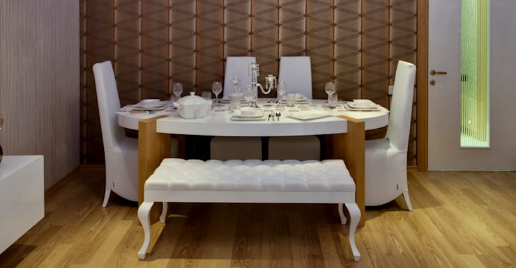 spider table:  Dining room by Hconcept Interiors London Ltd.