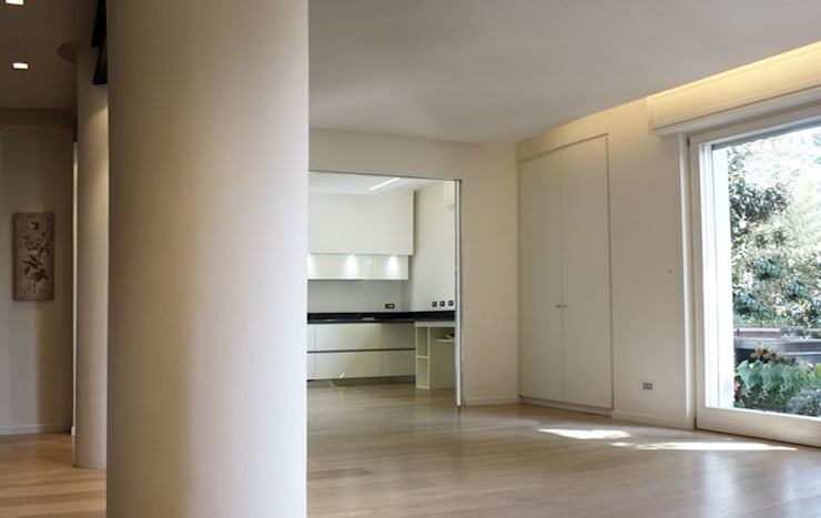 Casa Salzano: Soggiorno in stile  di Pier Maria Giordani Architetto,