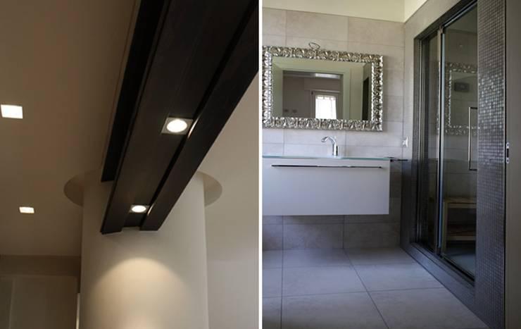 Casa Salzano: Bagno in stile  di Pier Maria Giordani Architetto,