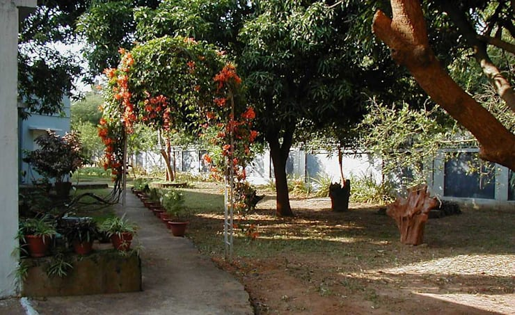 Jardines de estilo  por Anna Interiors