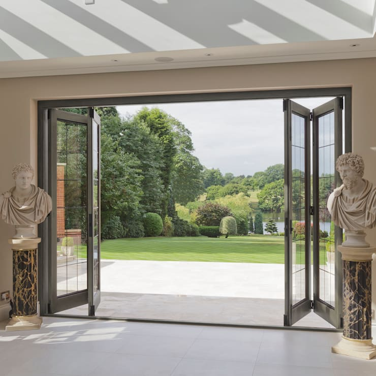 Bi-folding Timber Doors with Bronze Inserts:  Windows & doors  by Architectural Bronze Ltd
