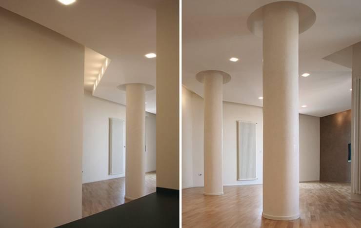 Casa AM: Soggiorno in stile  di Pier Maria Giordani Architetto, Moderno
