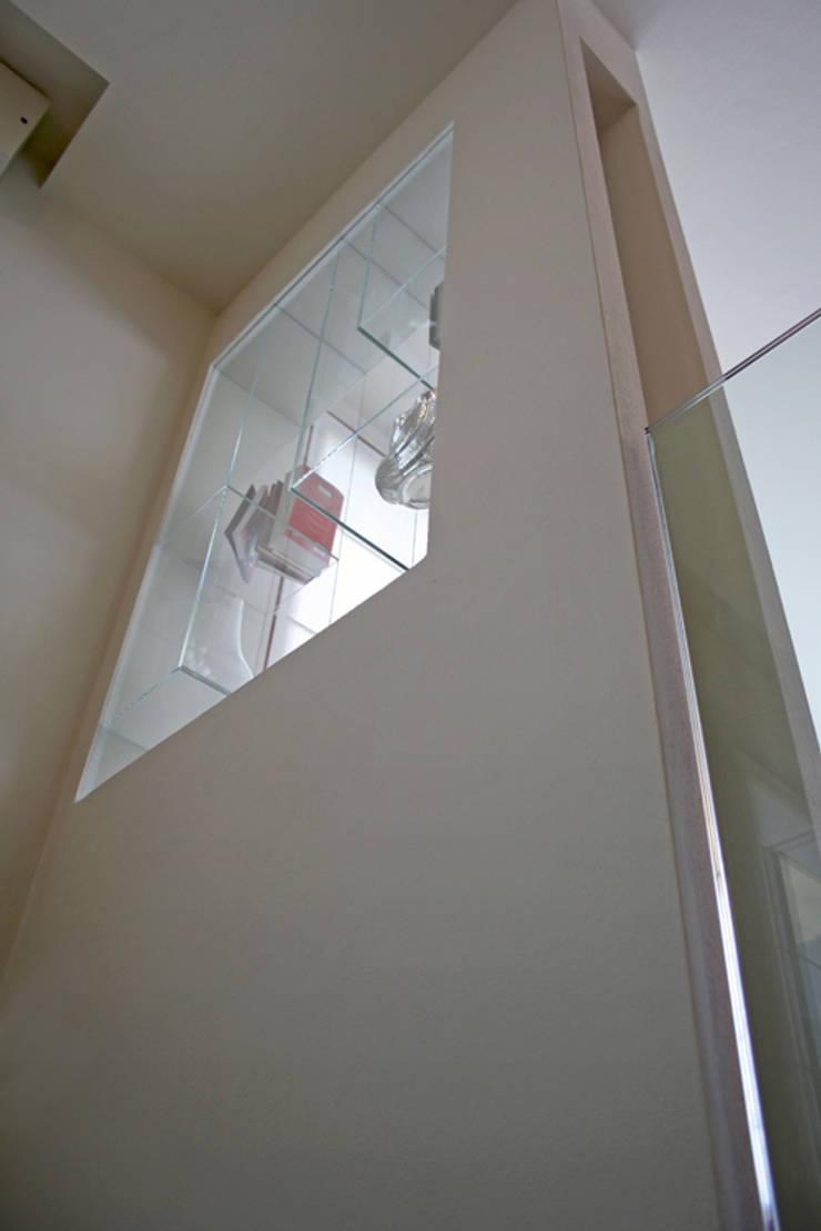 Casa GO: Pareti in stile  di Pier Maria Giordani Architetto, Moderno