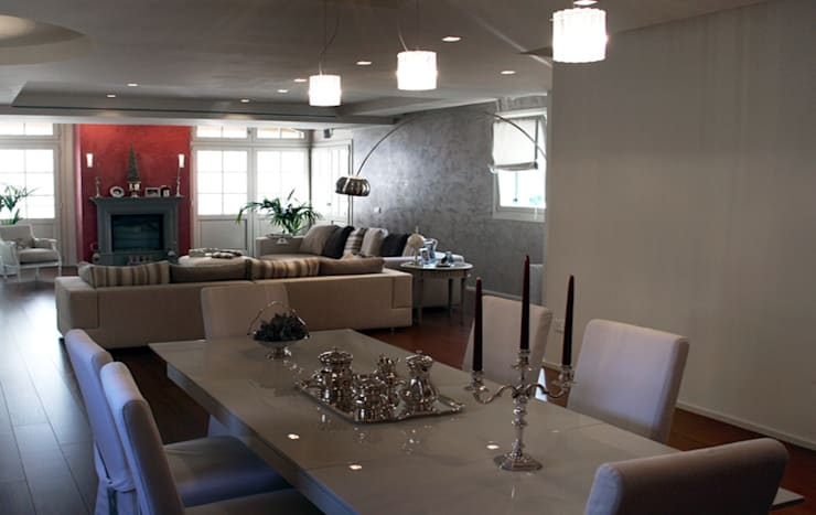 Casa Iasoni: Sala da pranzo in stile  di Pier Maria Giordani Architetto