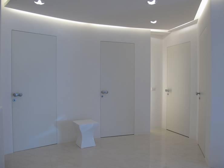 Abitazione-Atelier: Case in stile  di Architettura