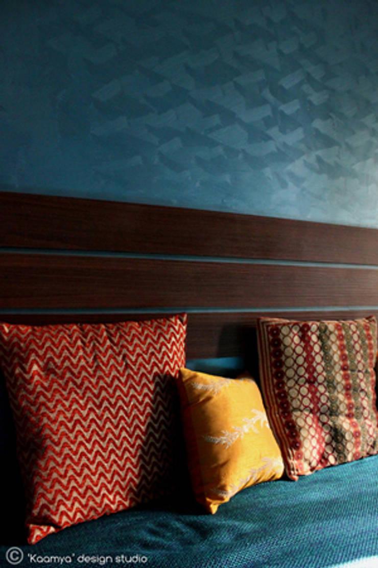 Living Room:   by kaamya design studio