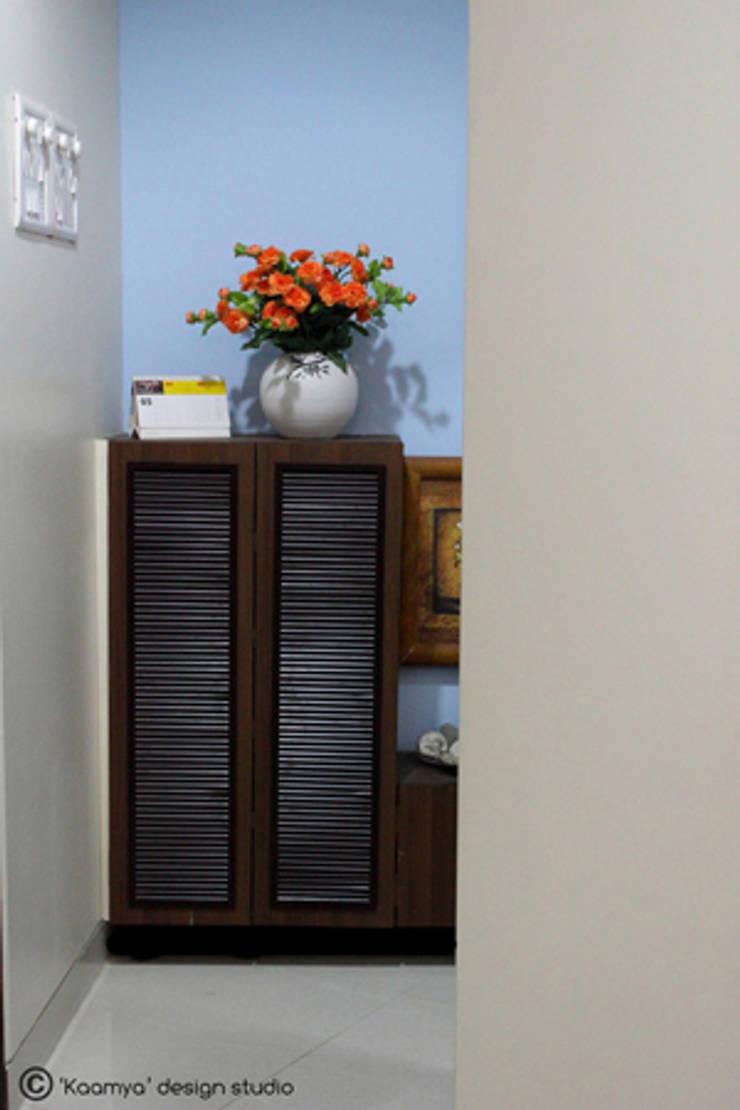 Shoe cabinet:   by kaamya design studio