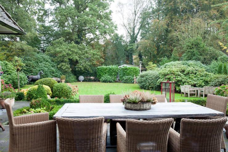 Einfamilienhaus :  Garten von schulz.rooms
