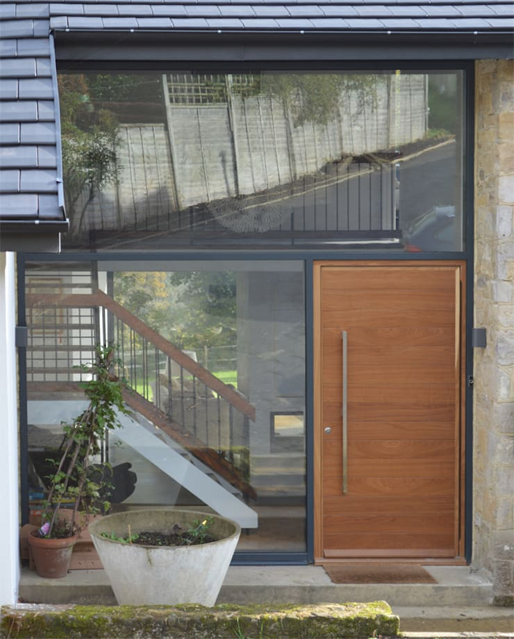 Pivoting hardwood timber front door:   by ArchitectureLIVE