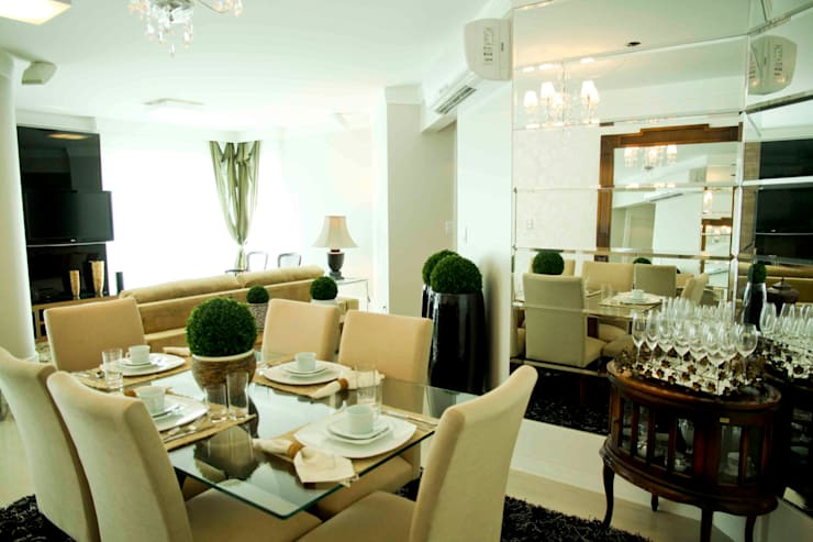 Apartamento : Salas de estar  por Daniela Vieira Arquitetura