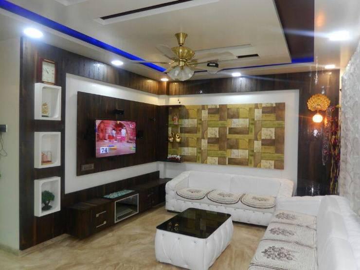 living rooms:  Living room by ajinkyainteriors