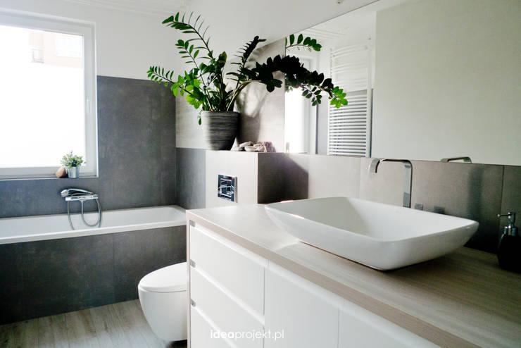 Baños de estilo  por idea projekt