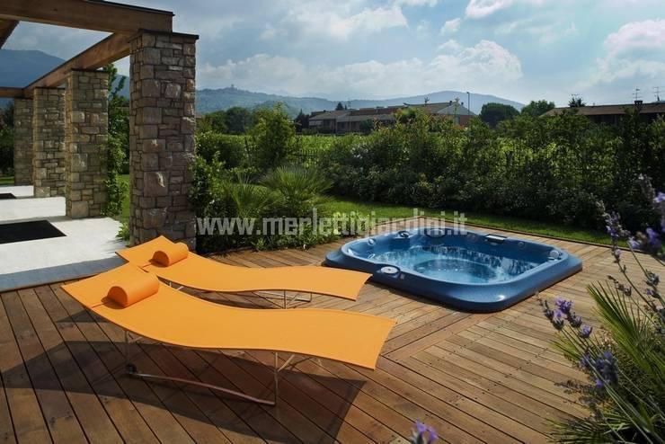 Giardino e complementi architettonici: Giardino in stile  di Merletti Garden Design,