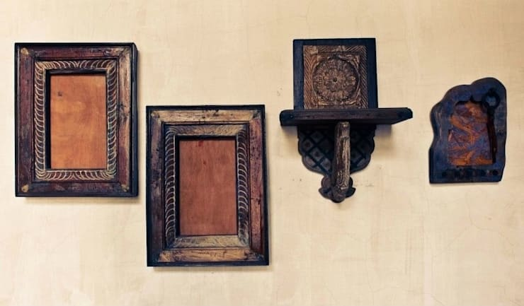 Frames and mirrors:  Corridor, hallway & stairs by Uttara And Adwait Furniture