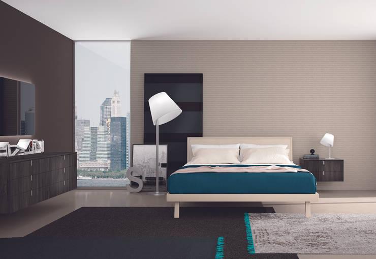 Dormitorios de estilo  por commercialeitalia