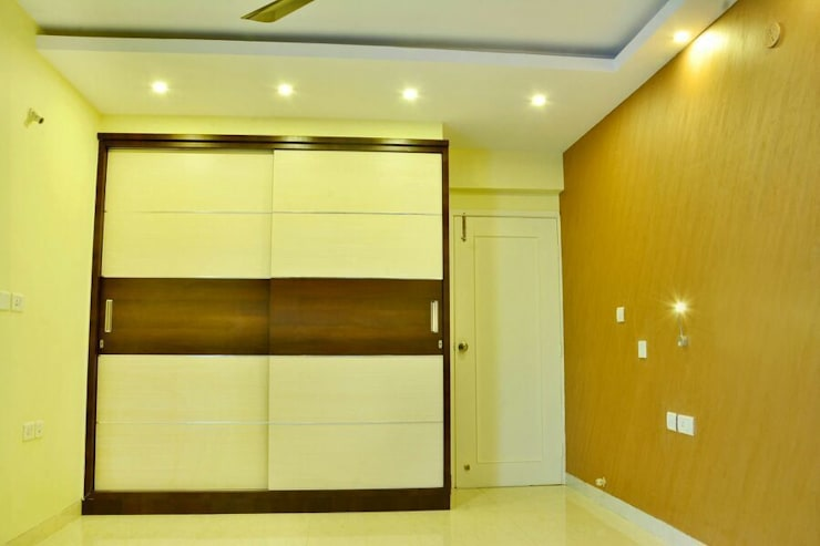 Creative Axis Interiors Pvt. Ltd.:  Bedroom by Creative Axis Interiors Pvt. Ltd.