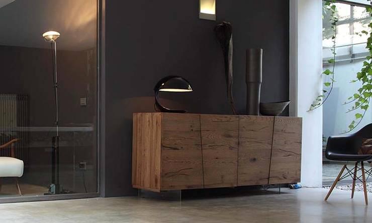 Salas/Recibidores de estilo rural por Muebles Capsir
