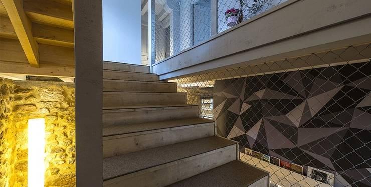 Hotel Garaiko Landetxea..: Casas de estilo  de Estudio TYL