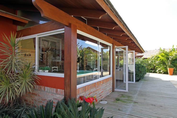 Projekty,  Domy zaprojektowane przez Graça Brenner Arquitetura e Interiores