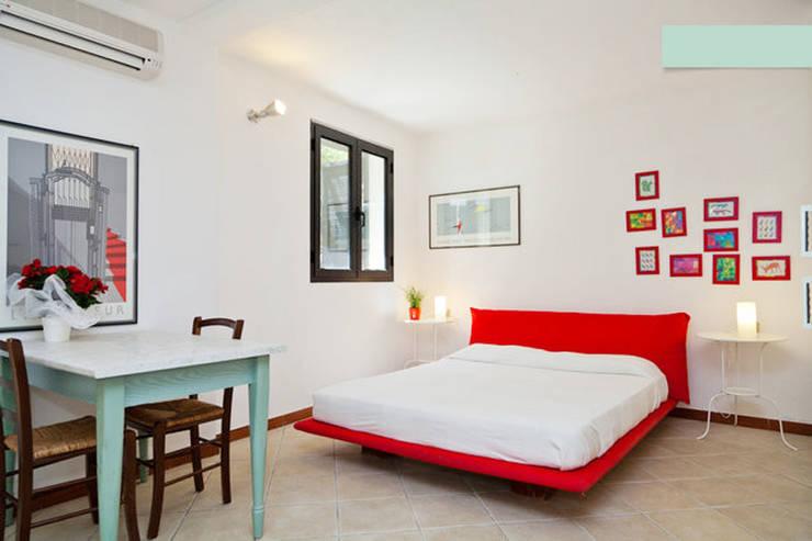 Monolocale Il Nido_Home Staging: Case in stile  di ArchEnjoy Studio