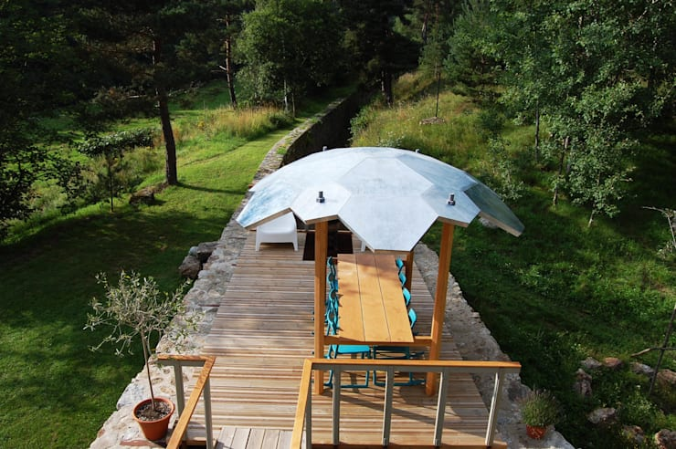 Oak outside table with integral zinc canopy:  Garden  by David Arnold Design