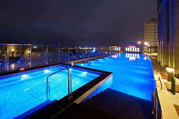 롯데시티호텔제주: 나우동인건축사사무소의  호텔