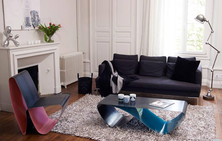 Fauteuil Infini: Salon de style  par Coco Steel
