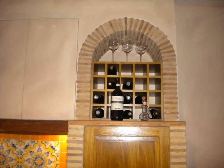 antico casale: Case in stile  di sandro trani designer,
