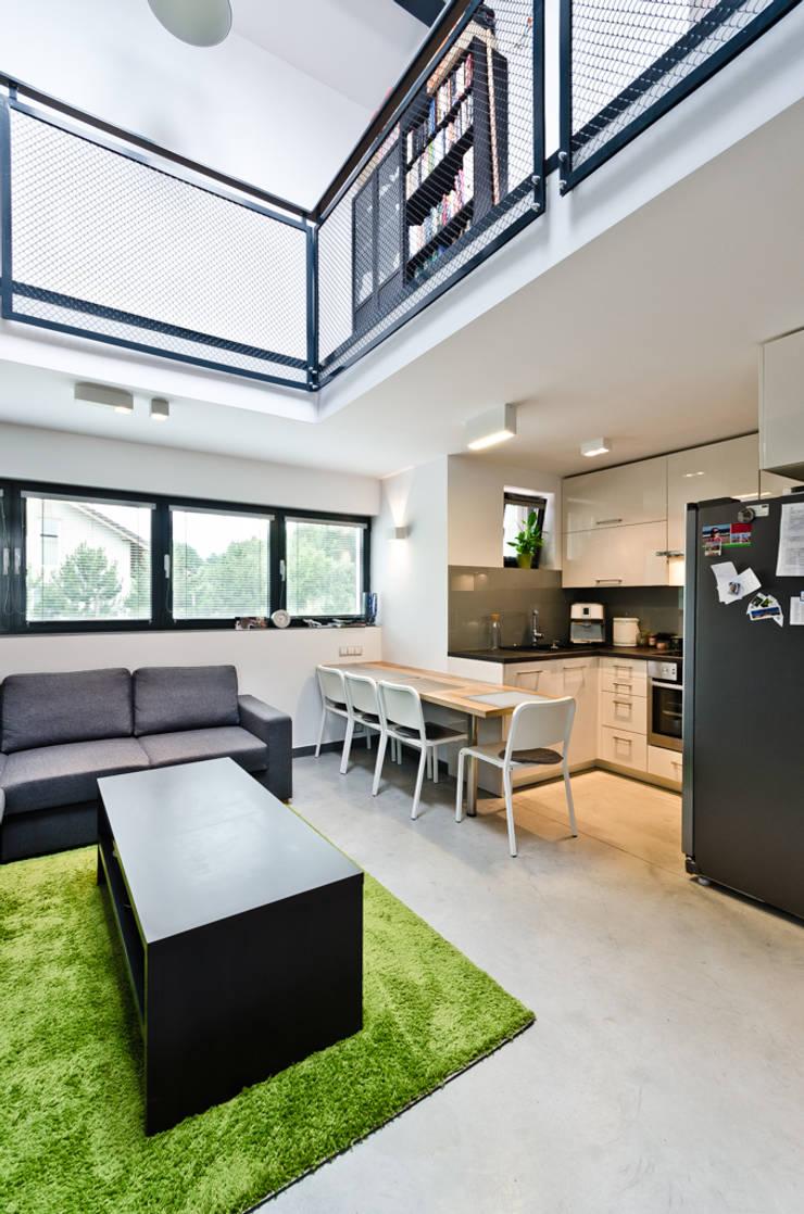 apartament dwupoziomowy: styl , w kategorii Jadalnia zaprojektowany przez ENDE marcin lewandowicz,Nowoczesny