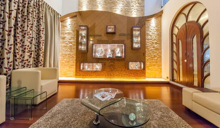 Formal Living Room:  Living room by Vishwanath And Associates
