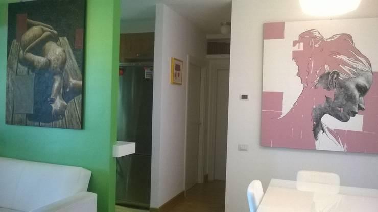 Ristrutturazione di interni: Case in stile  di piano a, Moderno