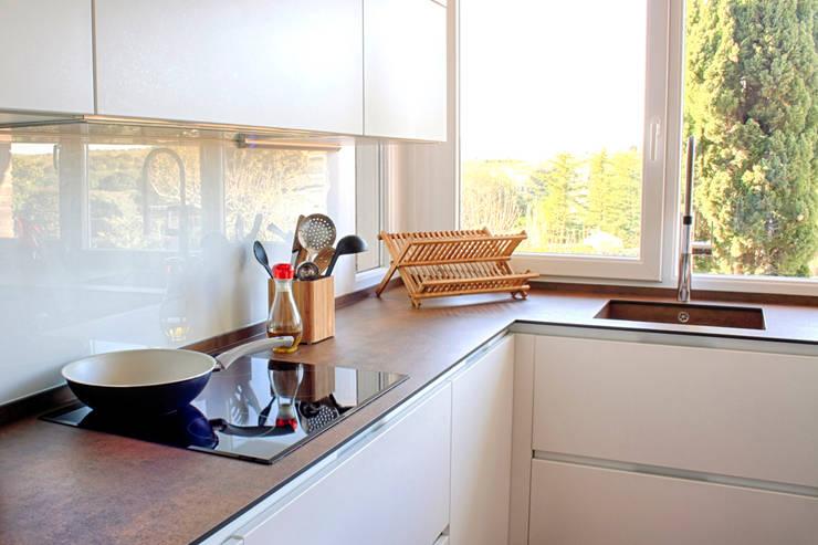 Vivienda STO DOMINGO_Madrid 1#: Cocinas de estilo  de Calizza Interiorismo