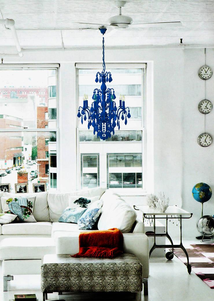 An electric blue flocked 8 lamp Jasmine chandelier:  Living room by Thomas & Vines Ltd