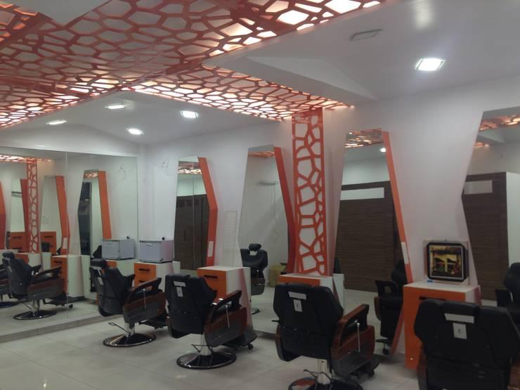 SALON: modern  by Moksha interior designer,Modern