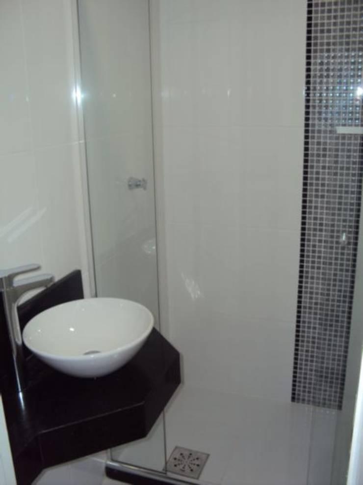 Banheiro: Banheiros  por Cristiano Carvalho Arquitetura e Design,Moderno