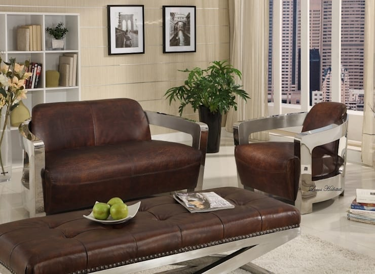 Two-seater leather sofa from Locus Habitat:  Living room by Locus Habitat