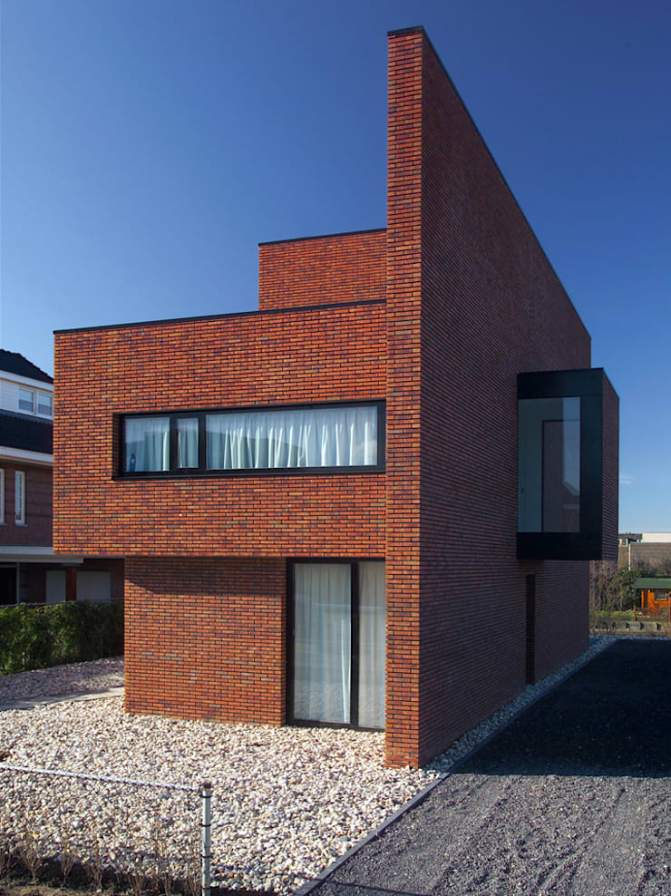Brick Wall House:  Huizen door 123DV Moderne Villa's