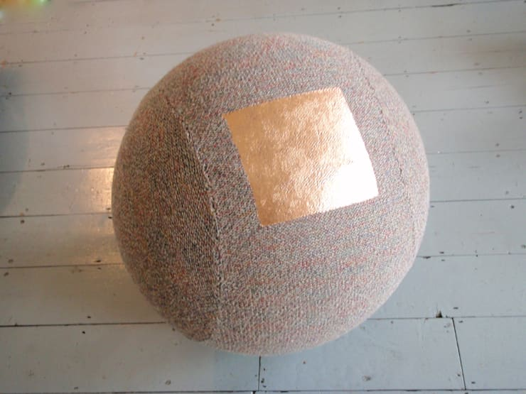 Copper foil on Tweed Seating sphere:  Living room by Mary Goodman
