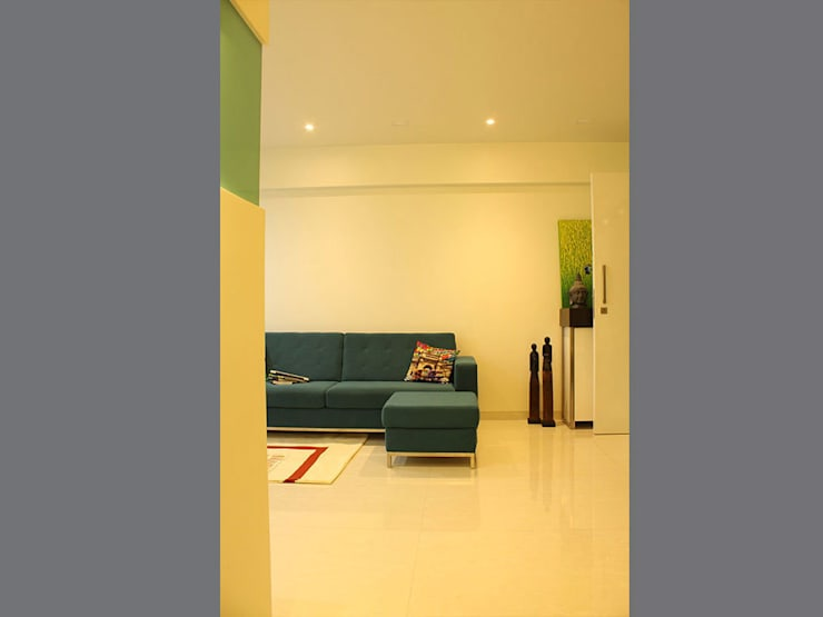 s k designs - contemporary residence in Kandivali:  Living room by S K Designs