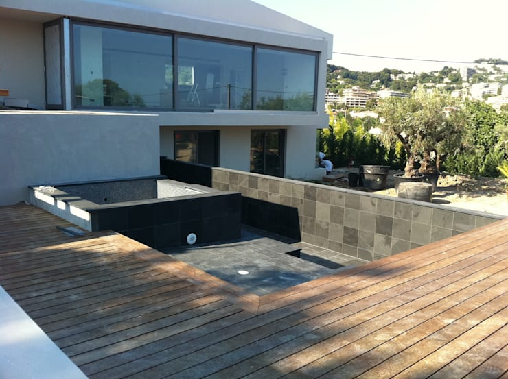 piscine ardoise: Piscine de style  par Vente Pierre Naturelle