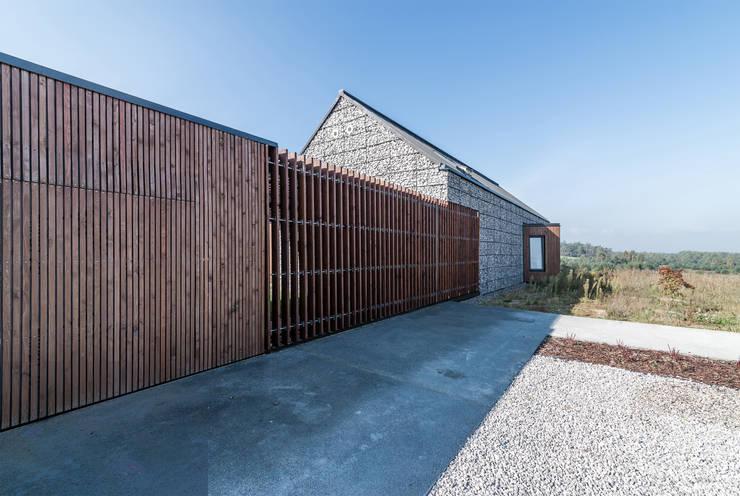 Casas de estilo  por Kropka Studio