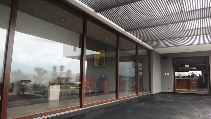 Casa LC: Terrazas de estilo  por ze|arquitectura