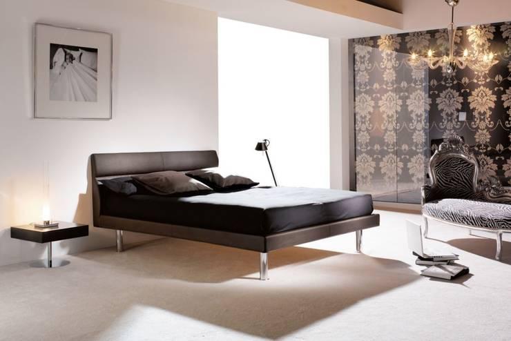 Cama de Diseño Tapizada Rock: Dormitorios de estilo  de Ámbar Muebles